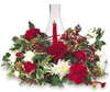 Christmas hurricane arrangement with red carnations, white mums and Christmas greens.